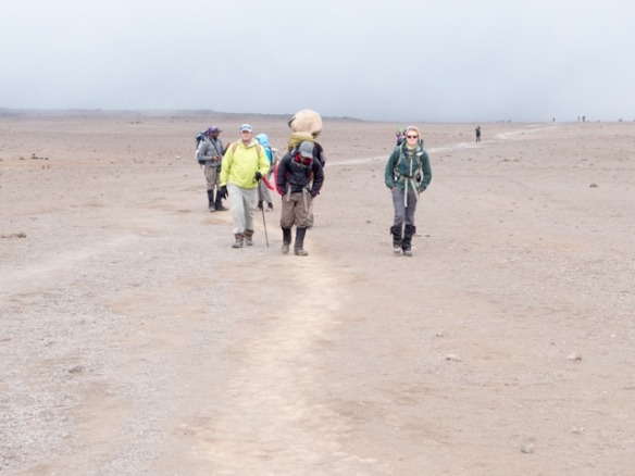 """Hiking across the Saddle from Mawenzi to Kibo.  The landscape is a bleak as it looks. """"Moonscape"""" comes to mind."""