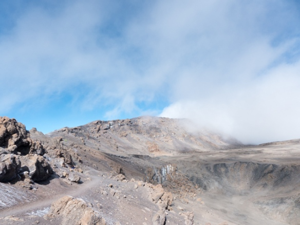 A view of Kibo's crater and Uhuru Peak in the distance.