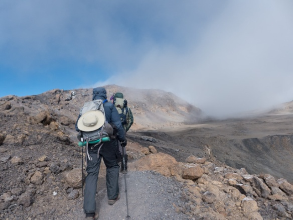 Hiking along Kibo's crater rim toward Uhuru Peak.